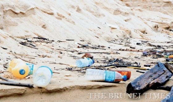 Plastic bottles strewn around at Berakas beach yesterday. Picture: BT/Ridhwan Kamarulzaman