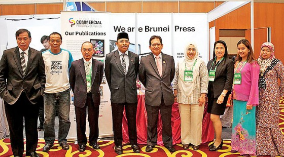 Pehin Dato Seri Setia Awg Hj Suyoi stops by the Brunei Press booth. – PHOTOS: DANIAL NORJIDI